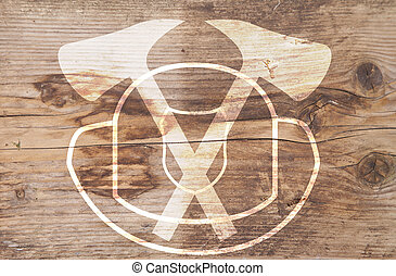 Illustration of white helmet and axes on brown wooden...