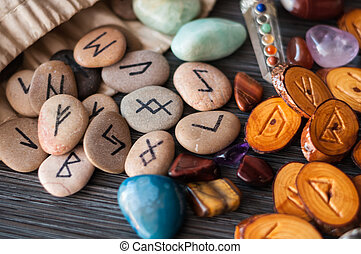 magic runes with their hands - wooden, rune stone with his...
