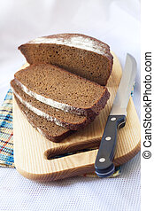 Loaf of wholegrain bread cut on slices