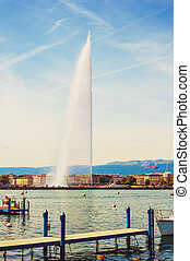 140 meters water fountain Jet D'eau on Lake Geneva, Switzerland, toned image