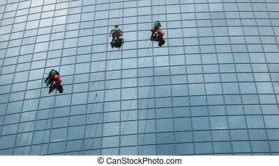 window cleaners at work - timelapse with window cleaners at...