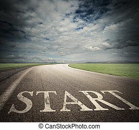 Start of business career - Word start written on asphalt...