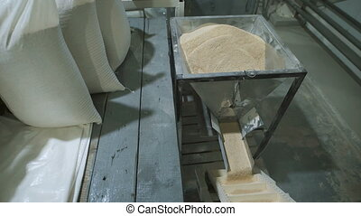 oatmeal cereal is packaged in bags at the factory. The food...