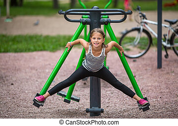 Little girl is engaged in fitness