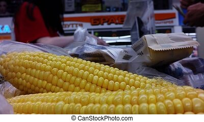 Corn buying in a storeEscalator shopping center - Corn...