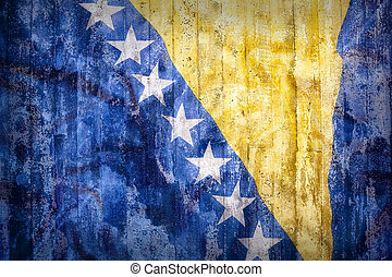 Grunge style of Bosnia and Herzegovina flag on a brick wall...