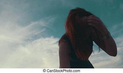 Red hair young girl stand up on motor boat. Summer evening....