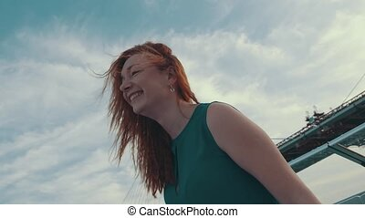Red hair happy girl on motor boat Laugh in camera Summer...