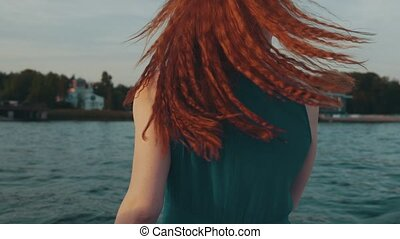 Red hair happy girl in motor boat. Enjoy summer evening....