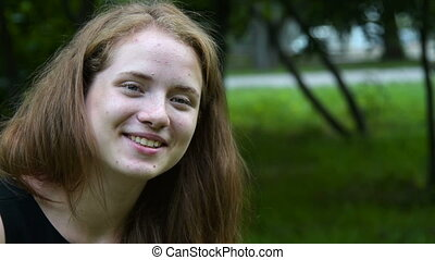 Laughing teen girl with flecks - Portrait of a laughing...
