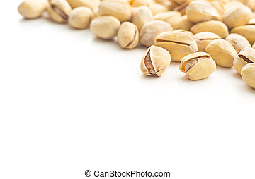 The pistachio nuts. - The pistachio nuts isolated on white...