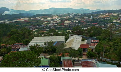 Upper View of Wide Town with Small Houses among Hills -...