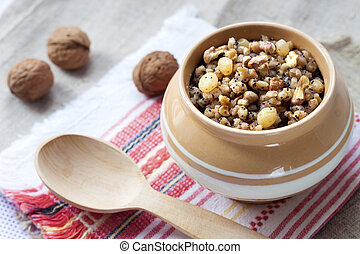 Kutia - sweet grain pudding, the traditional first dish of...