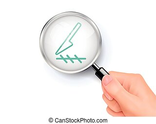 Scalpel cut icon sign showing through by magnifying glass...