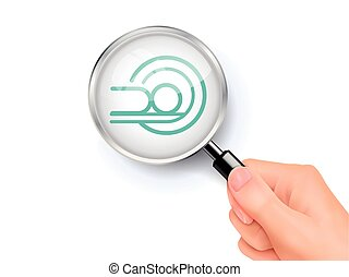 MRI icon sign showing through by magnifying glass held by...