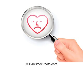 Sad heart icon sign showing through by magnifying glass held...