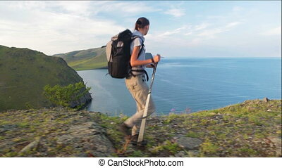 Hiker woman is walking mountain, - Hiker woman walking on...