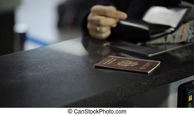 Passport of Russian Federation lies on reception desk in...