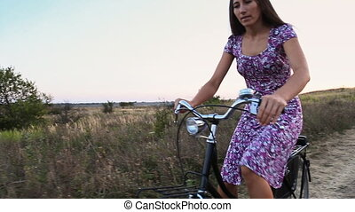 Girl with a bicycle - girl with a bicycle in nature