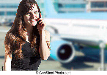 Young brunette woman in the airport