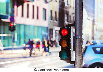 Crossroads with traffic lights in the city - Pedestrians and...