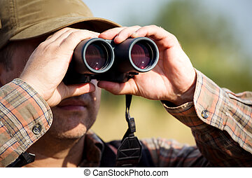 Hunter hunting - Man hunter with shotgun looking through...