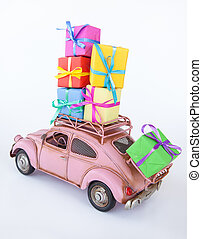 Vintage car with gift boxes - Vintage car staked high with...