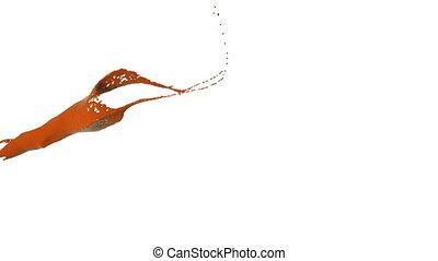 orange color splash in slow motion. Colored paint - close-up...
