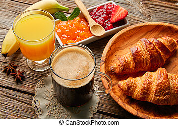 Continental breakfast croissant coffe orange juice -...