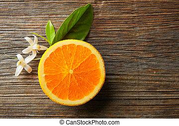 Cut open orange fruit with orange flower - Cut half open...