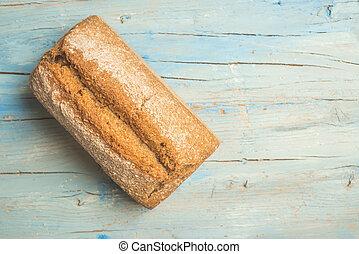 Artisan spelt bread background - Artisan spelt bread on blue...