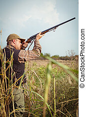 Hunter hunting - Hunter aiming the hunt during the hunting...