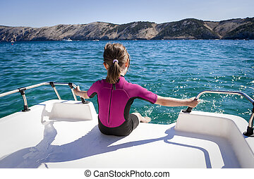 Child Relax on Boat - Little girl sitting at the back of the...