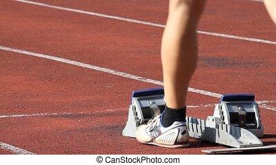 sprintstart - athlet in sprint start in track and field