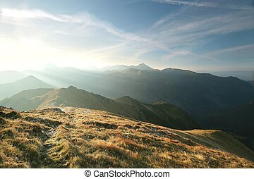 Peaks in the Tatra Mountains during sunrise.