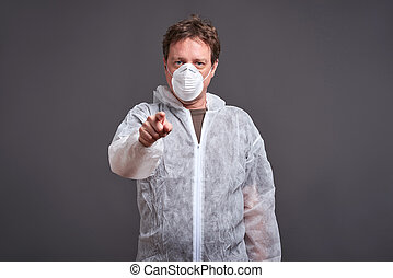 Man in a clothes protector suit - A middle aged man standing...