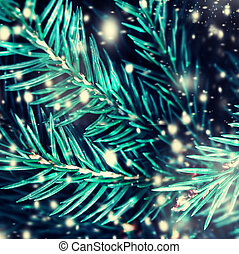Closeup of Christmas tree background with falling snow....