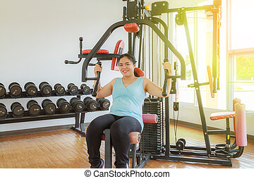 Training in the gym - Asia fat woman training arm equipment...