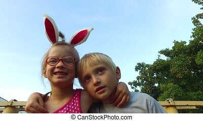 Girl with ears and glasses and boy with white hair fun...