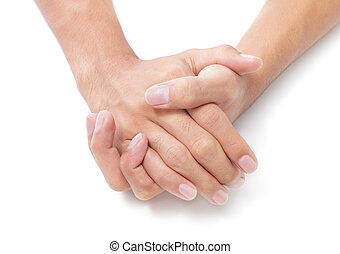 Two folded hands - Two male hands folded on white desktop...