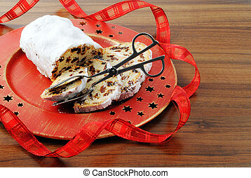 Christmas stollen cake on platte with ribbon and cake tongue