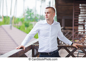 businessman standing on balcon alone