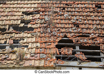 Broken tile roof - Detailed view of abandoned building with...