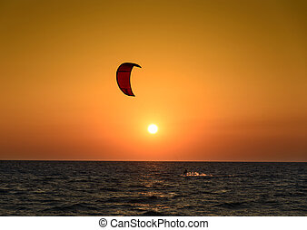 Kite surfing - Kite surfer silhouette at beautiful sunset at...