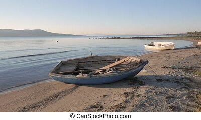Empty small wooden boats on the beach. 4k