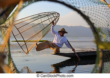 Fisherman with net at Inle lake - Myanmar travel attraction...