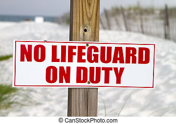 No Lifeguard On Duty - Sign posted at a beach notifies...