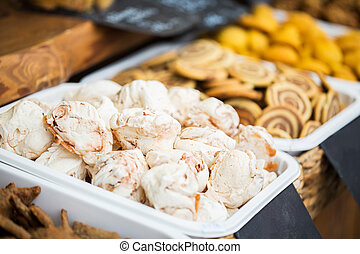 close up of meringue cookies on serving tray
