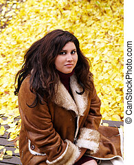 Plus-sized model in jacket with autumn leaves - Heavy...