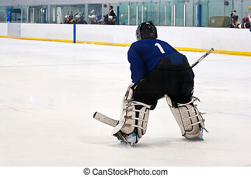 Hockey Goalie - A hockey goalie awaiting the return of the...